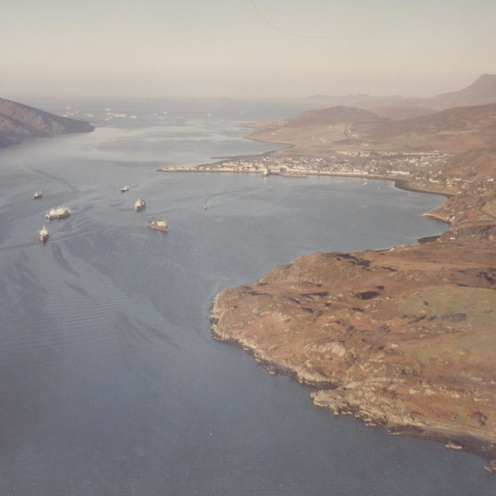 View of Ullapool with fishing boats